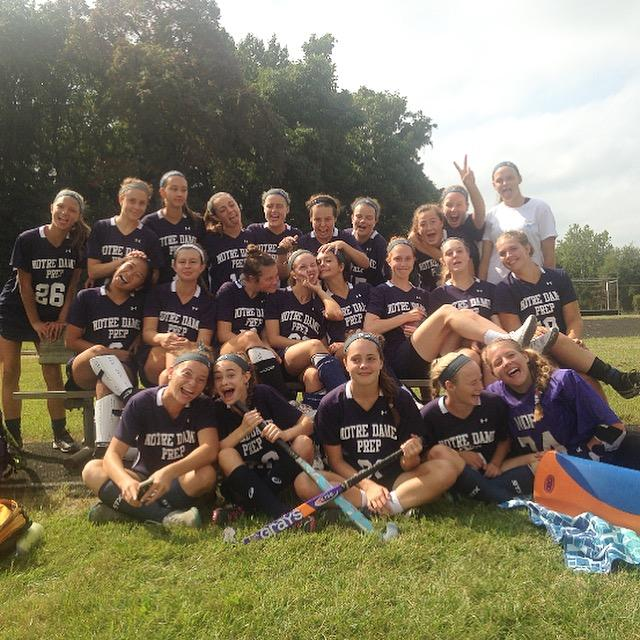 The+field+hockey+team+taking+a+silly+picture+after+winning+their+game