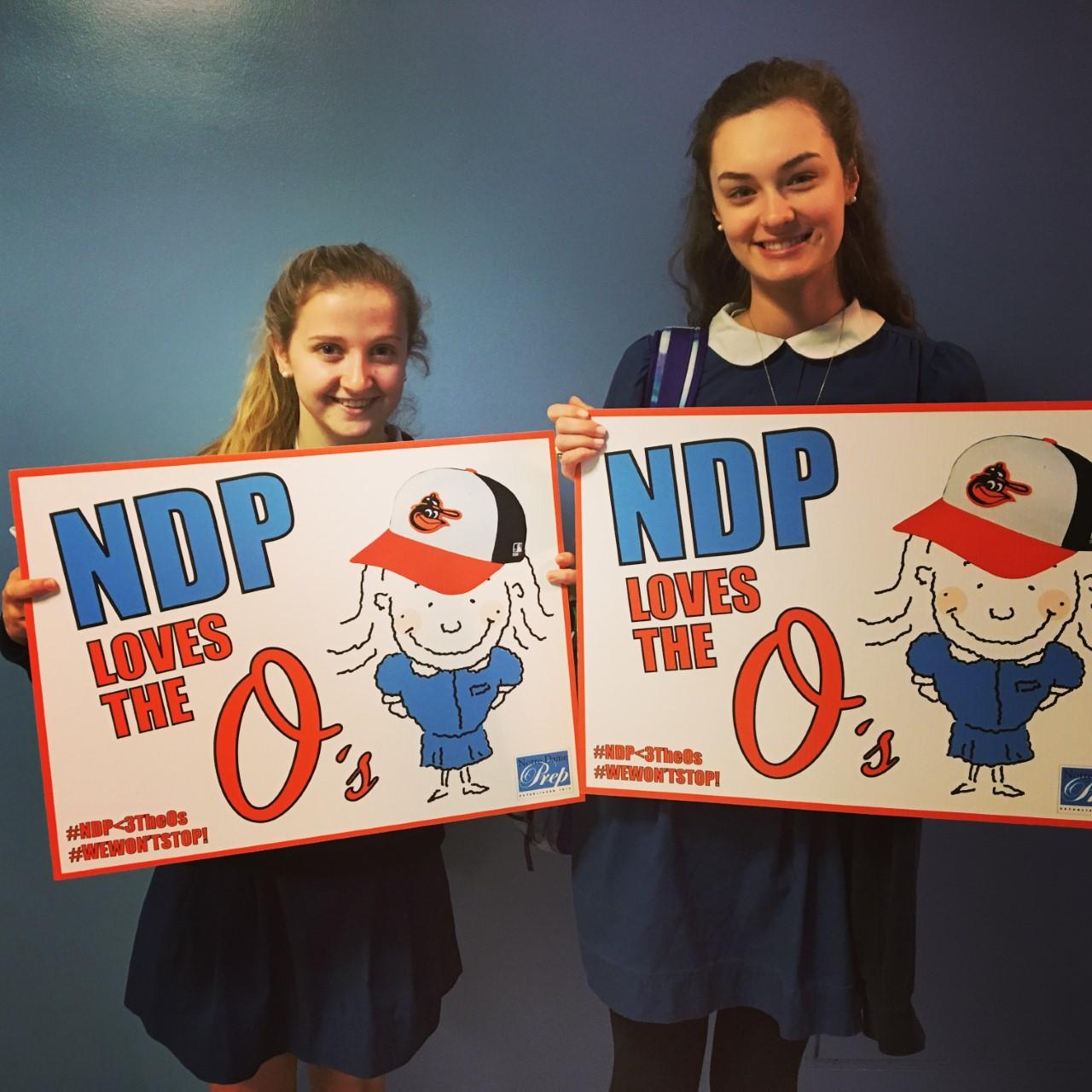 NDP girls show their love for the Orioles with signs!