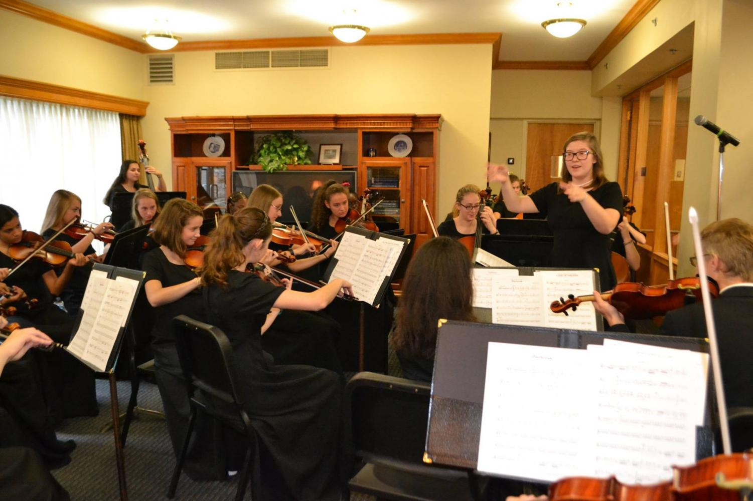 The NDP String Orchestra prepares to play at Open House 2017