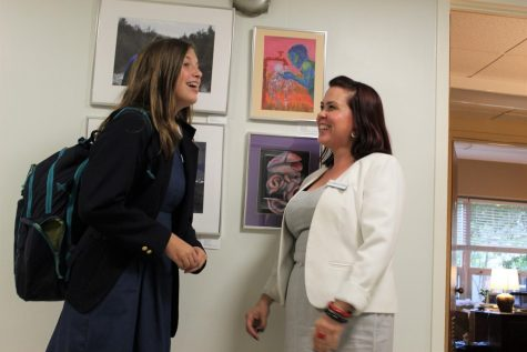 Ms. Kotarides, Upper Level Dean of Students, speaks with Isabella Conoscenti