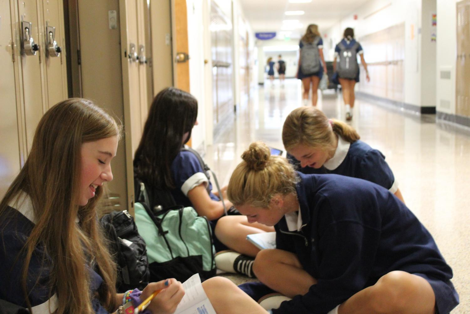 Members of the Class of 2022 work on their homework in the Science wing.