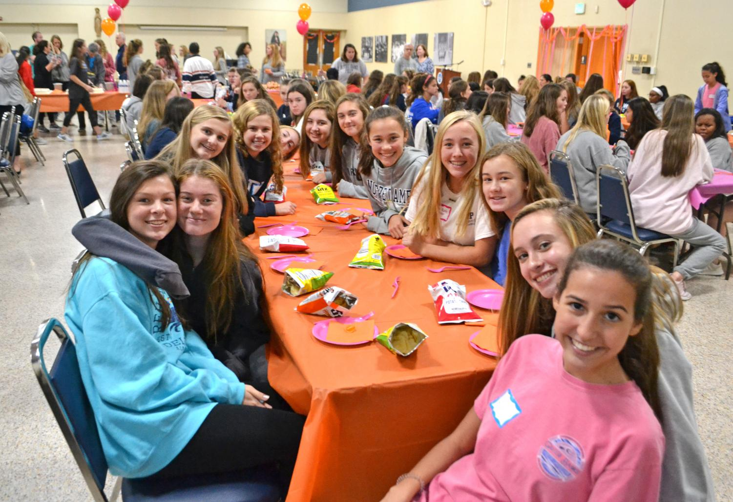 Members of the Class of 2023 gather in the dining room after retreat.