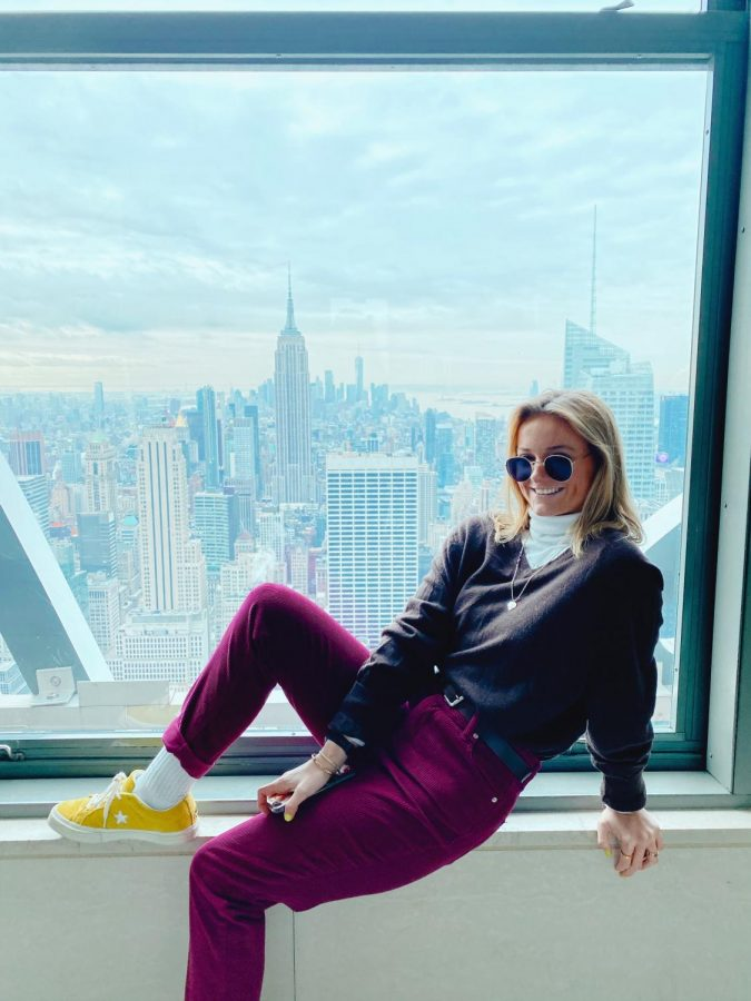 Grace Hayden lounges with a view of New York City.