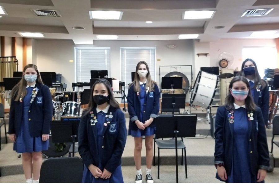 Musicians from the Tri-M National Music Honor Society prepare for the spring concert.