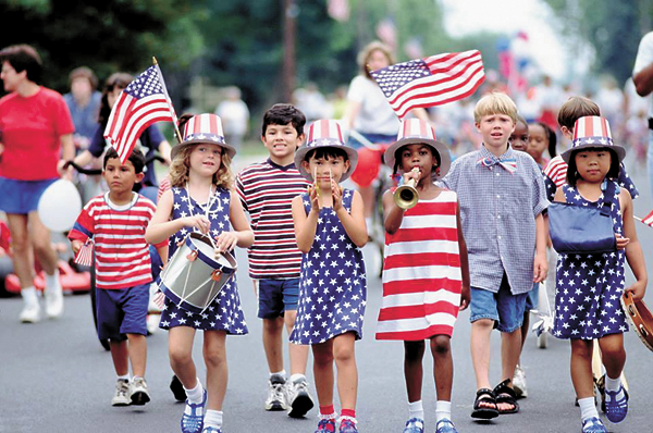 These children are enjoying a Labor Day parade to honor all of our American workers.
